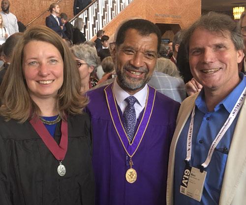 Christine Mondor receives FAIA medal. Also pictured: Bill Bates, president of AIA, and Marc Mondor of evolveEA.